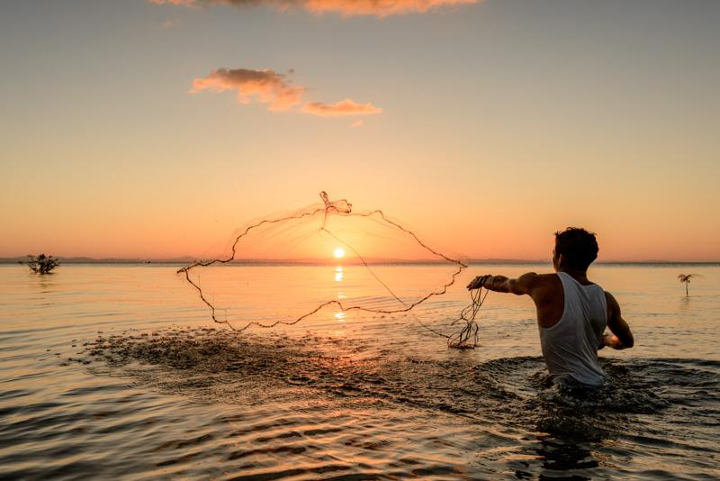 Cast net and sunset on Lake Nicaragua
